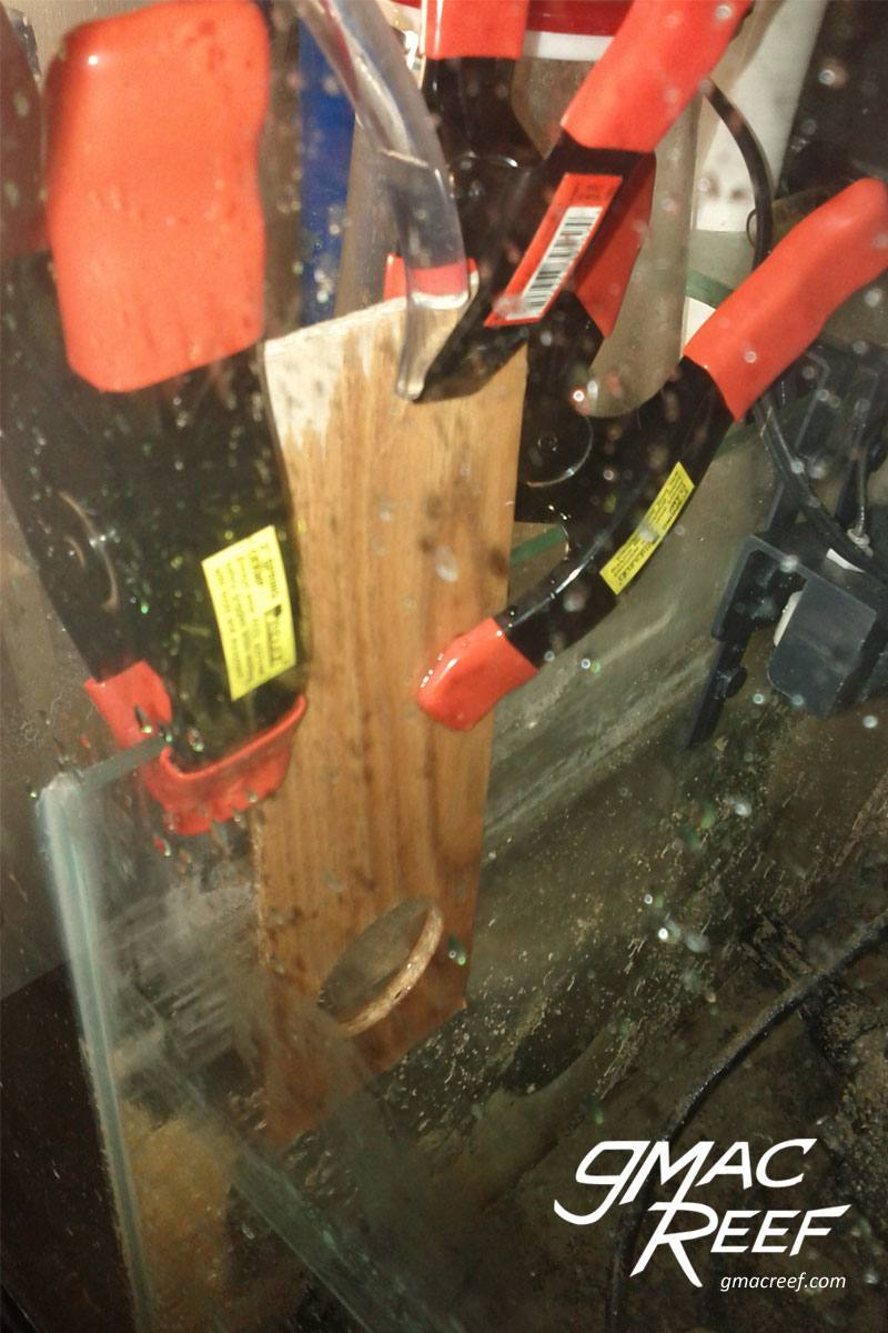 Clamps holding a wood template to guide the drilling bit