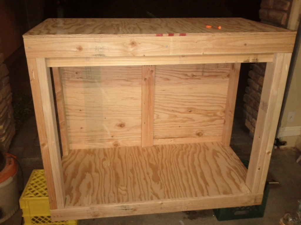 Reef tank stand with plywood floor, backing and tank bottom added to frame